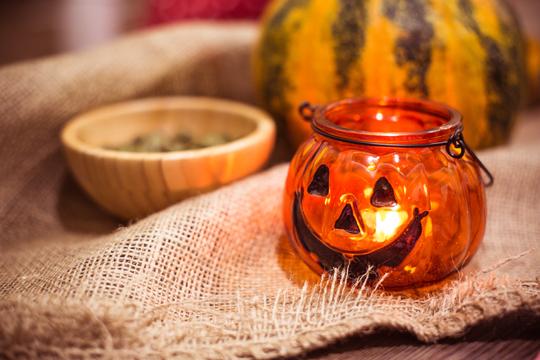 preparing-for-halloween-pumpkin-candle-holder-picjumbo-com