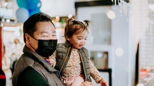 Father holds daughter at Lonsdale Quay Market